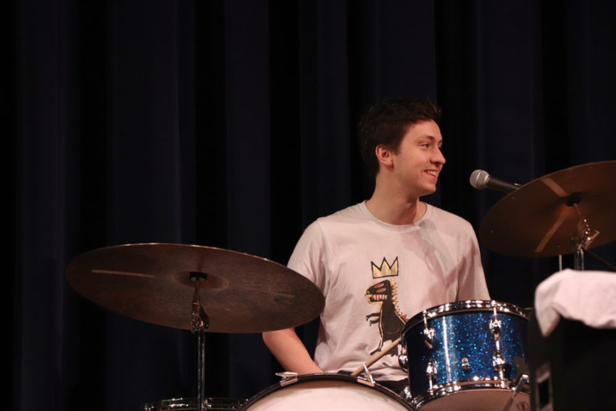 Drummer and vocalist Matt Bent takes a short break during a trumpet solo.