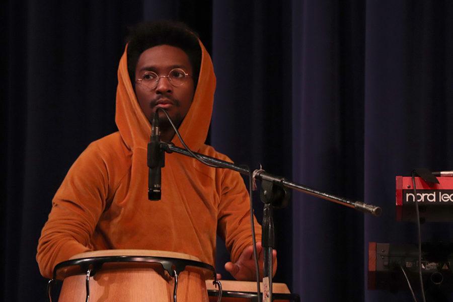 Percussionist Geraldo Marshall plays the conga.