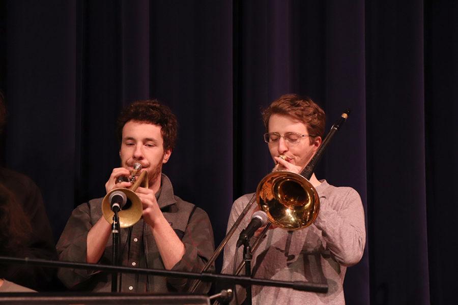 Band members Ben Bird and Adrian Eldridge play trumpet and trombone, respectively.