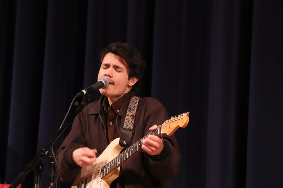 Greg Robers sings a solo during one of the band's early songs.