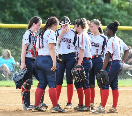 Infielders talk to their starting pitcher senior Hannah Brown during an away game at Rockbridge County High School prior to the start of the inning.