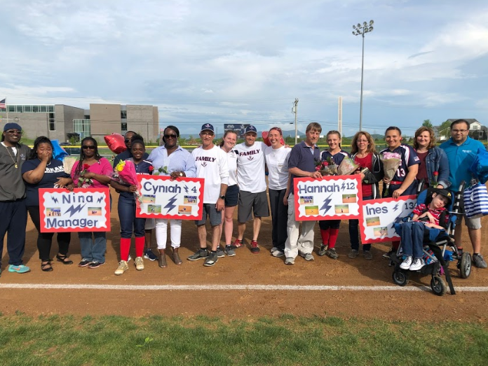 Manager Nina Andrews, second baseman Cyniah Stuart, pitcher Hannah Brown and first baseman Ines Lopez-Flores are recognized on May 2 for senior night alongside their family members and coaches.