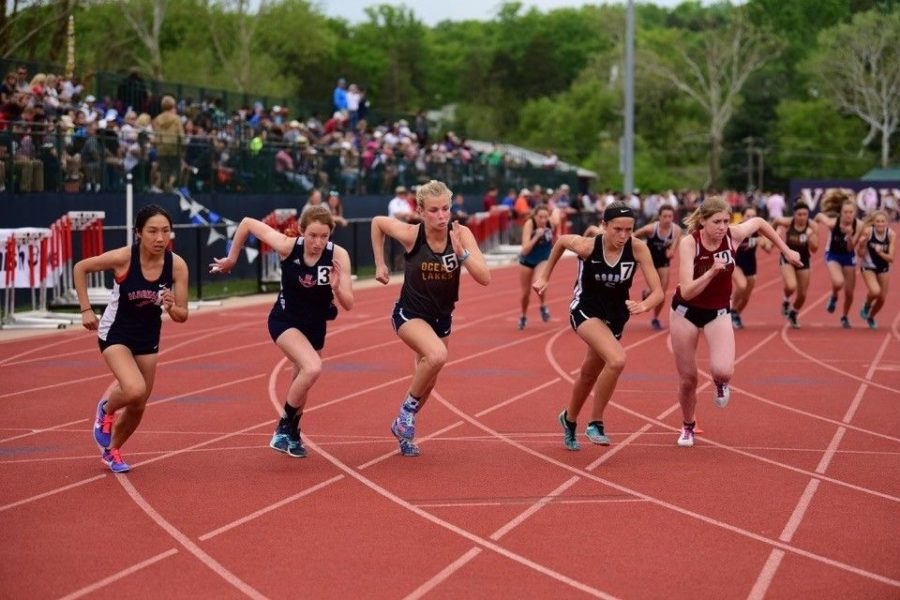 Senior Hannah Miller (second from left) competes in the Dogwood Track Meet in Charlottesville at University of Virginia. Miller runs for the Streaks in cross country, indoor track and outdoor track. She plans on continuing her running career at Elon University in the fall.