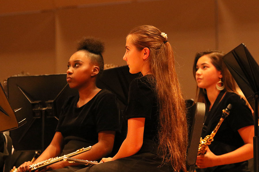 Sophomore Dorothy Yates (left) waits for director Claire Leepers instruction in the Concert Band.