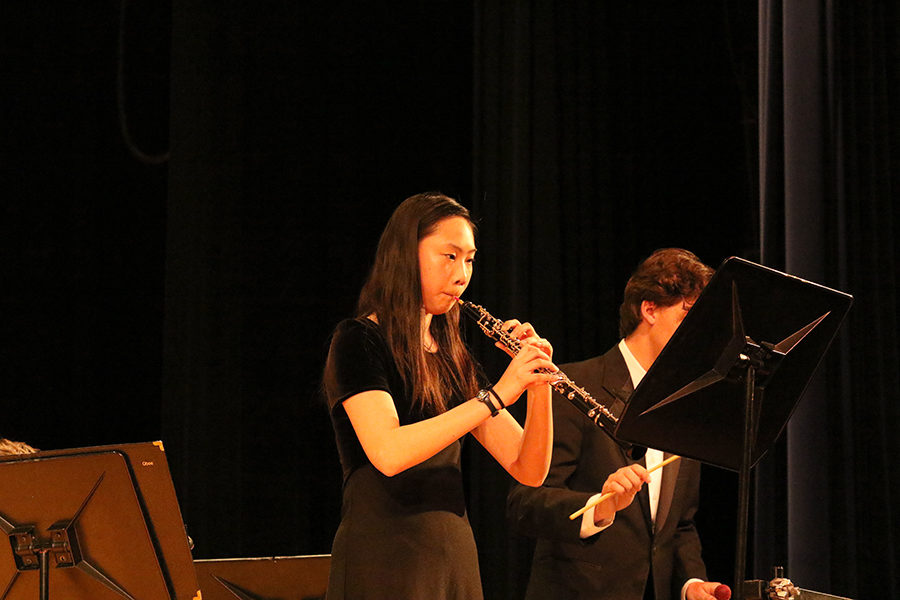 Senior Irene Liu is recognized as a senior with a solo in the front of the stage during the combined band performance.