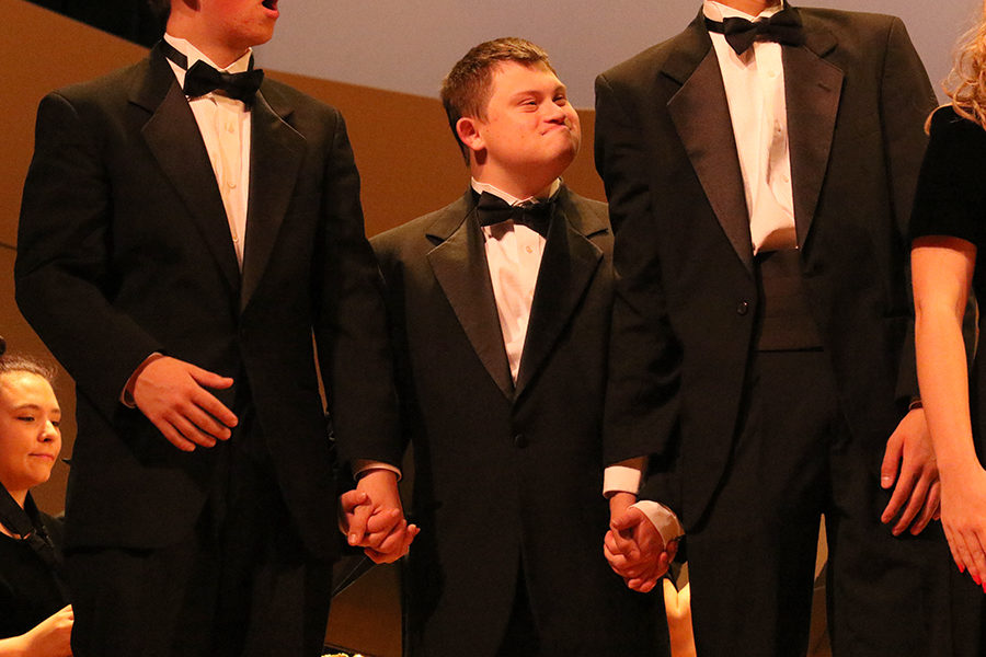 Junior Jack Hotchkiss (left), special education student Donnie Winton (middle), and Sophomore Stanley Inouye (right) are recognized after the performance of HHSs United Sound Band, a combination band with the special needs students.