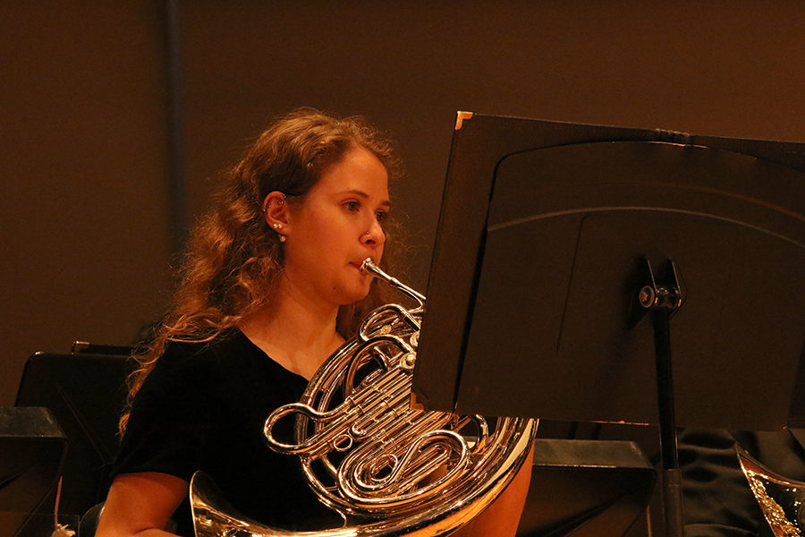 Sophomore Tessa Lohnes plays the French Horn in the Symphonic Bands opening song.