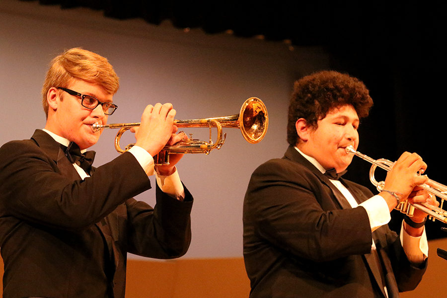 Symphonic band seniors Ryland Jones (left) and Ronal Gomez (right) are recognized as seniors with solos at the front of the stage.