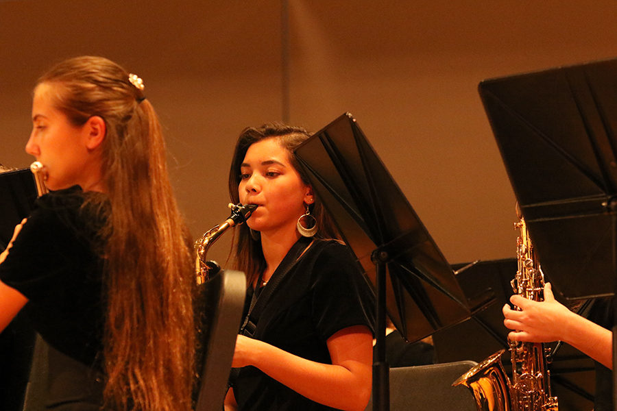 Freshman Sophia Yoder plays the saxophone as a part of the Concert Band.