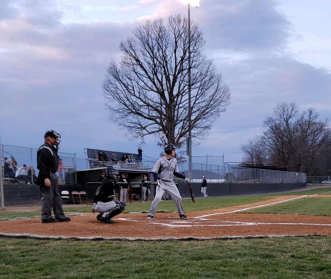 Sophomore Aidan Perkins prepares to hit the ball when he's up to bat  against the Knights of Turner Ashby.