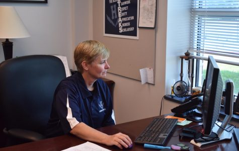 Melissa Hensley works on her computer during her first week as new principal of HHS in summer 2019.