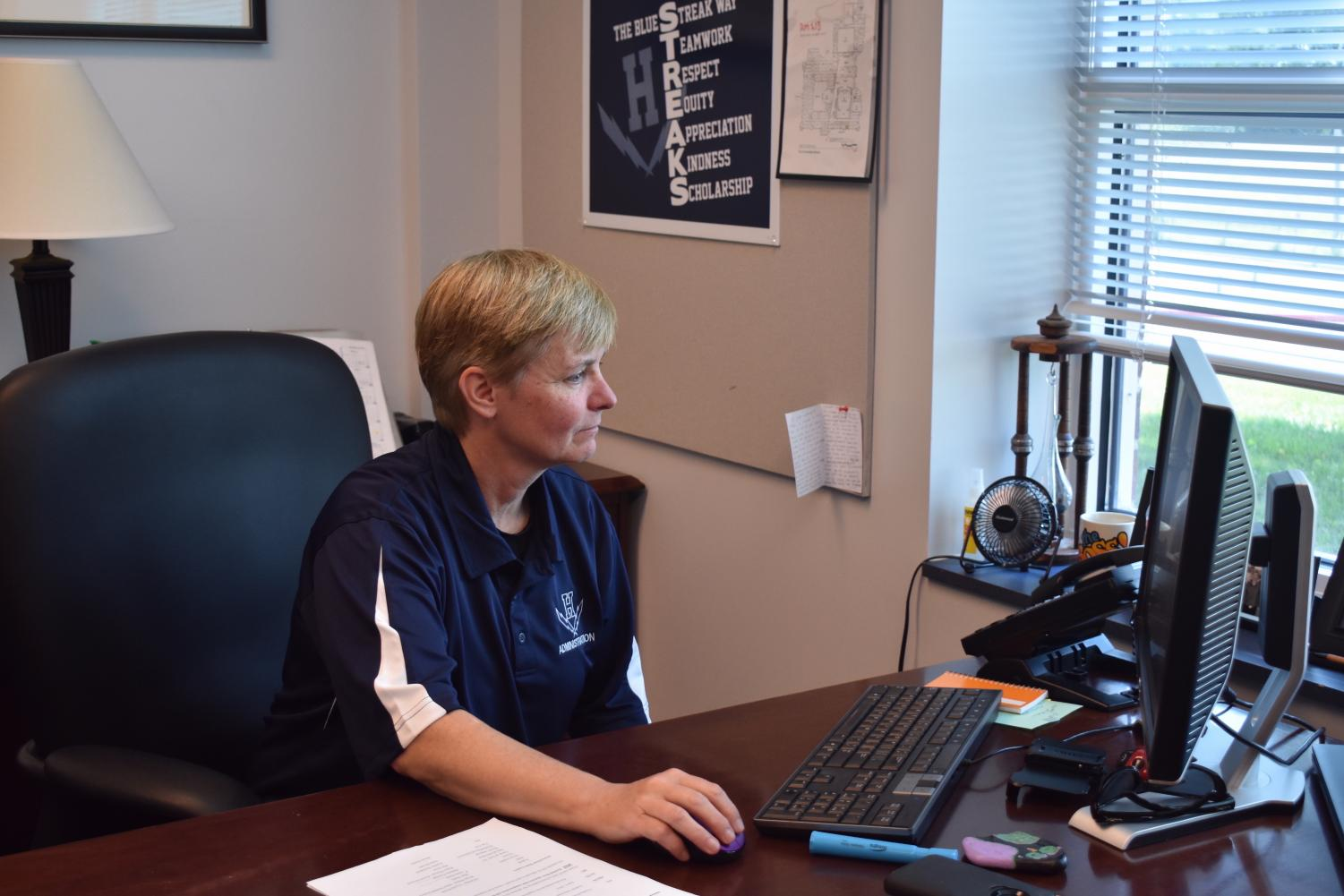 Melissa Hensley works on her computer during her first week as new principal of HHS.
