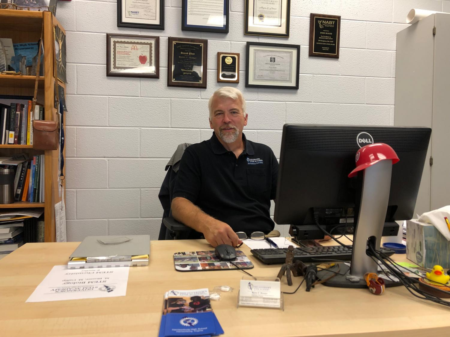 HHS STEM Coordinator and Biology Honors teacher, Myron Blosser, sits at his desk in the STEM office at room 500.