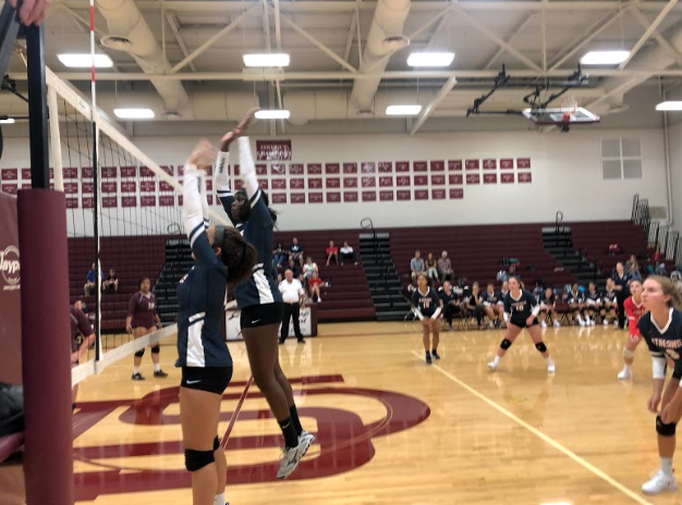 Sophomore Juju Butler and senior Atilia Thomas go up to block during the Streaks' loss against Stuarts Draft on Tuesday.