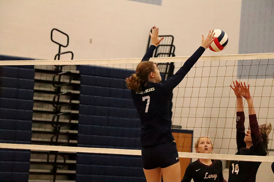 Freshman Kai Blosser gets a block during the JV volleyball game against the Luray Panthers. The Streaks lost 2-1.