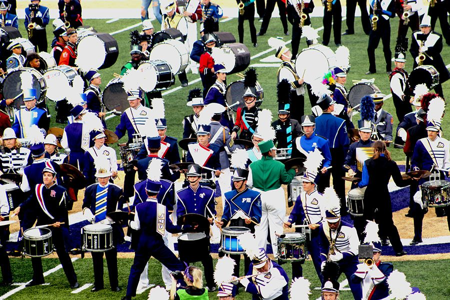 The+HHS+Band+performs+with+the+Marching+Royal+Dukes+along+with+other+bands+from+around+the+community+on+the+field.+