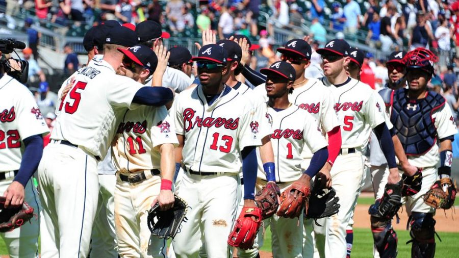Braves players walk off the field after winning a game earlier this season. Photo courtesy of MLB.com