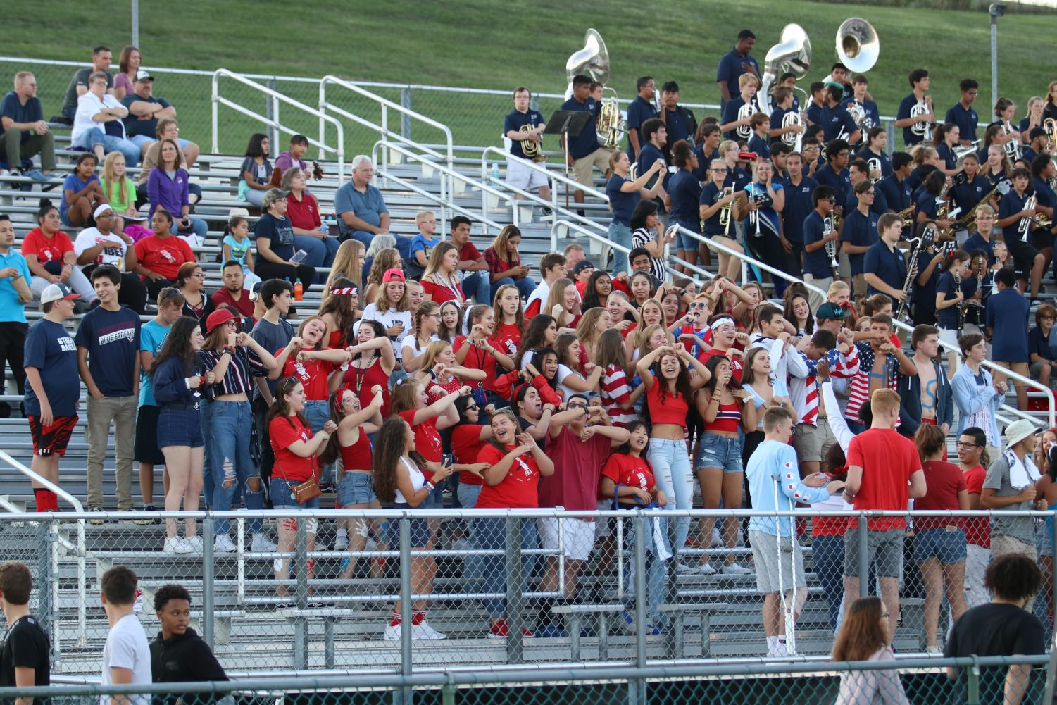 The+Red+Sea+student+section+supports+the+varsity+football+team+by+performing+their+signature+%22Wobble%22+dance.+