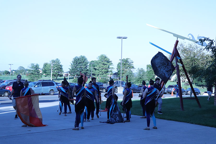 Color+Guard+warms+up+before+their+performance.
