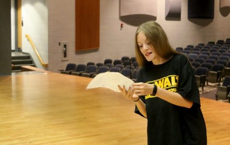 Freshman Ellie Velker reviews her monolouge. Upperclassmen give her advice on how to perfect it.