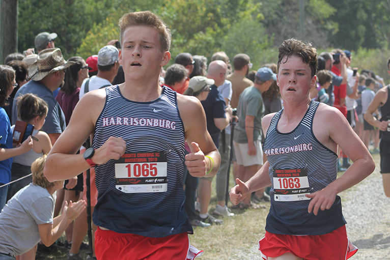 Senior+Tucker+McGrath+and+junior+Hayden+Kirwan+finish+their+second+mile+side+by+side.+Kirwan+came+in+57th+with+a+time+of+17%3A23%3A70+and+McGrath+came+in+71st+with+a+time+of+17%3A33%3A80.+The+team+came+in+14th+overall.+