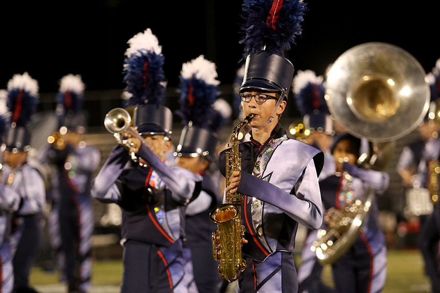 Senior Isaac North-Sandel performs during halftime on Sep. 20. This marked marching band's second performance of the year and the first with new uniforms and props.