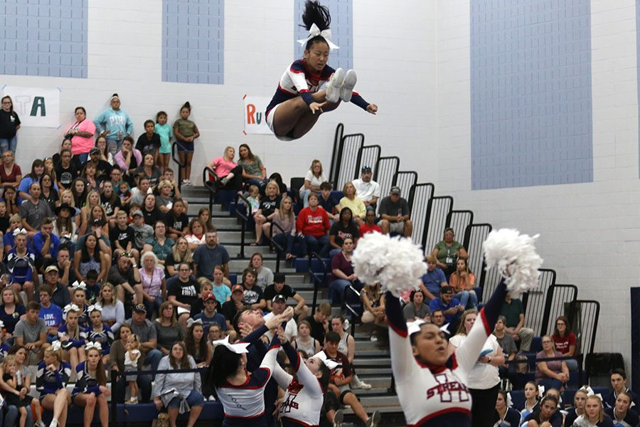 Junior Ruby Arndt pikes during a basket toss.