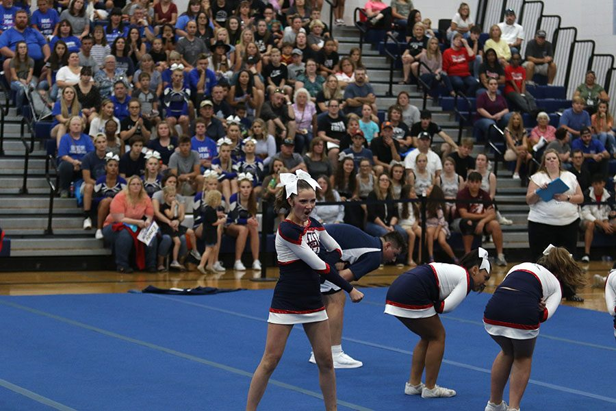 Junior Lizzy Healy participates in the completion cheer team's routine.