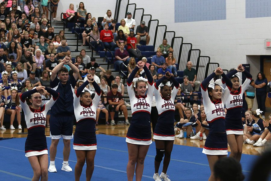 Members of the competition cheer team participate in the dance portion of the routine.
