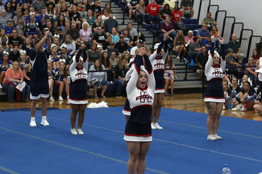 Junior Chloe Nichols participates in the competition cheer team's routine.
