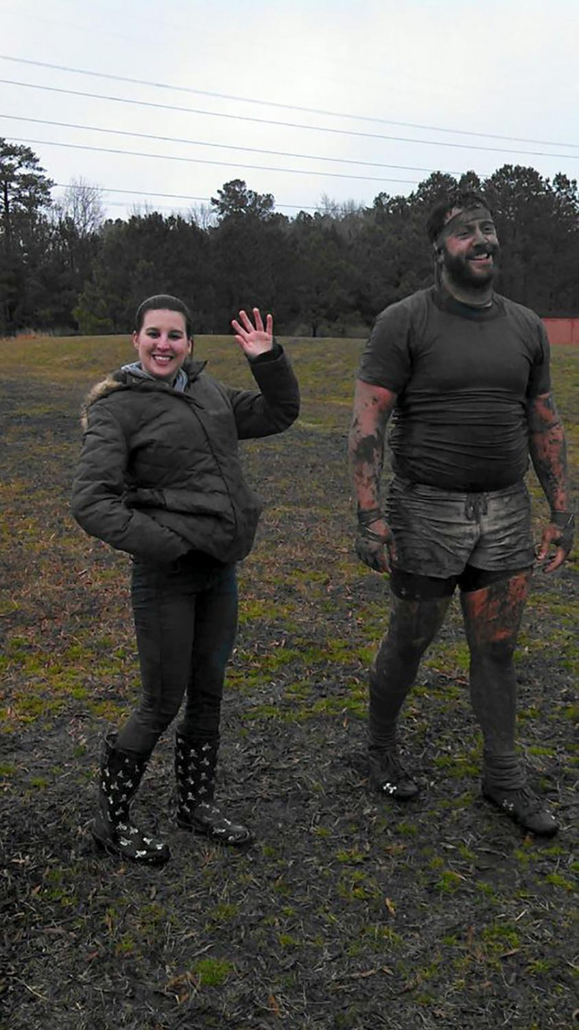 Kelly (right) after a mud run, a messy activity that was also a hard exercise.