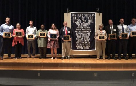 Members of the Hall of Fame class of 2019 receive their plaques made from the old football stadium.