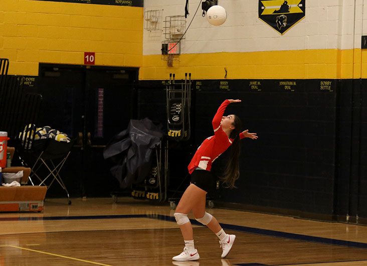 Senior Abby McCollum serves the ball during the first set of the Streaks' 3-0 loss to Rappahannock County.