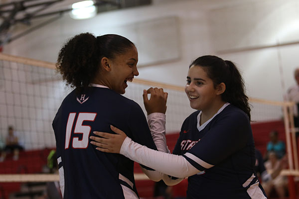 Sophomore Jay Garcia subs into a volleyball game for junior Maddie Shanholtz. The bond created by team sports like these is something that can last a lifetime.