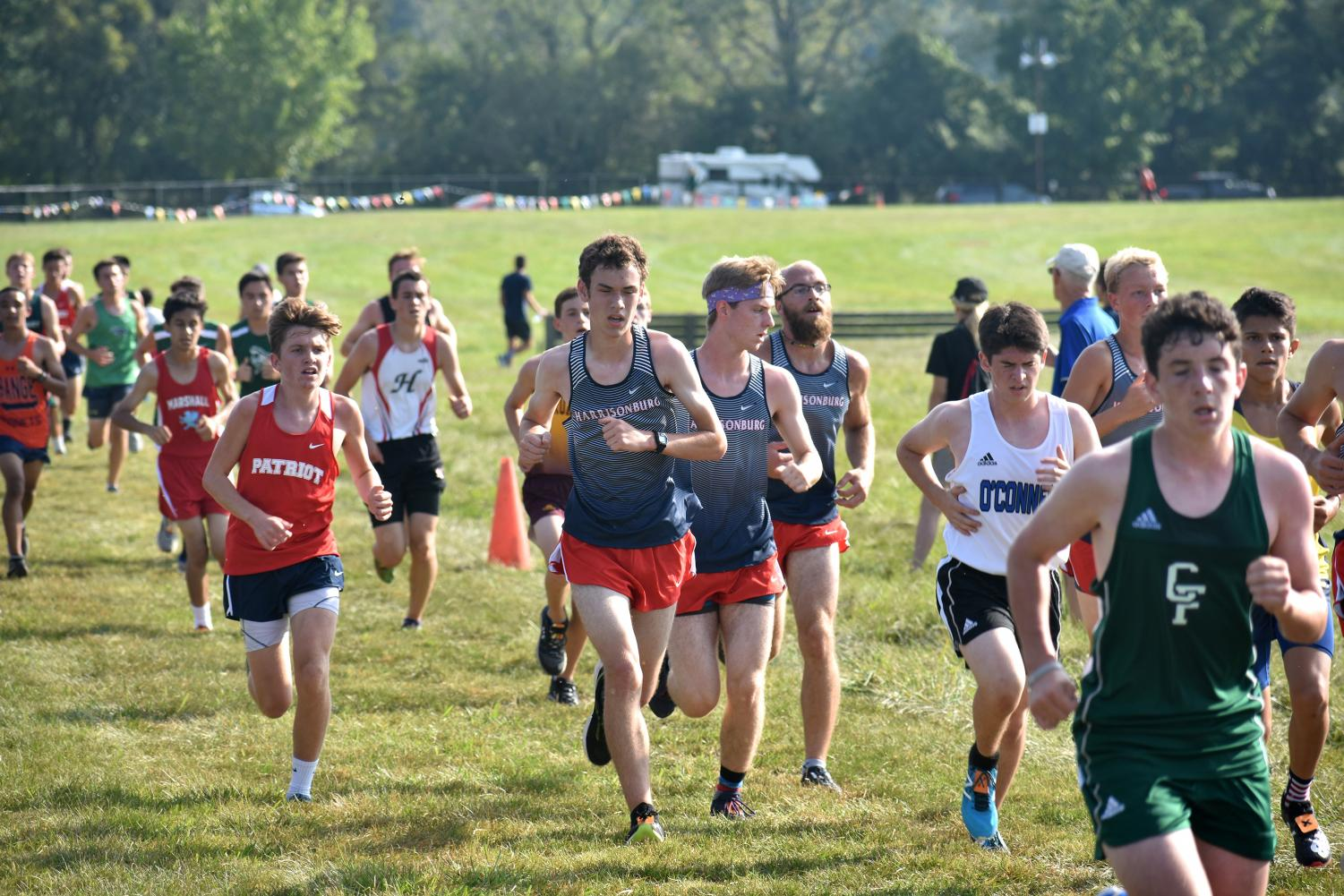 Seniors Alex Neufeld, Michael Hulleman and Elias Wickline run as a pack during the first mile.