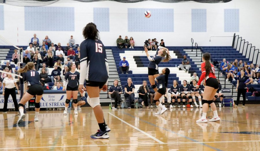 Junior Sophie Sallah hits the ball from the back row.