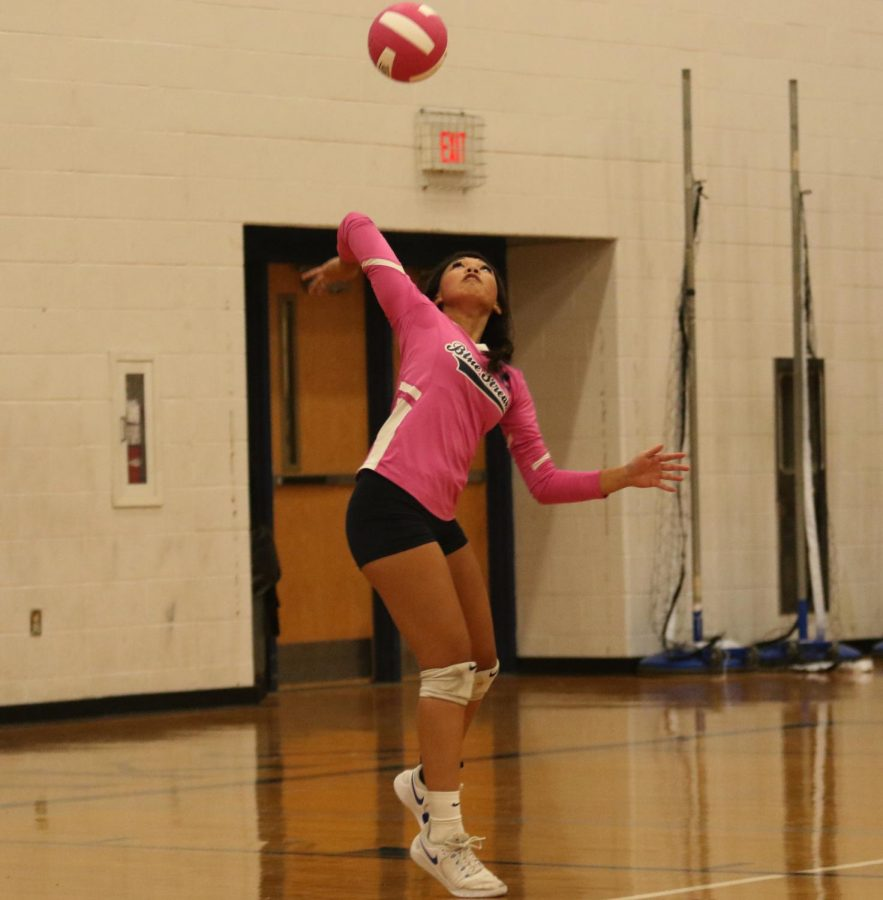 Phengsitthy serves the ball during the second set.