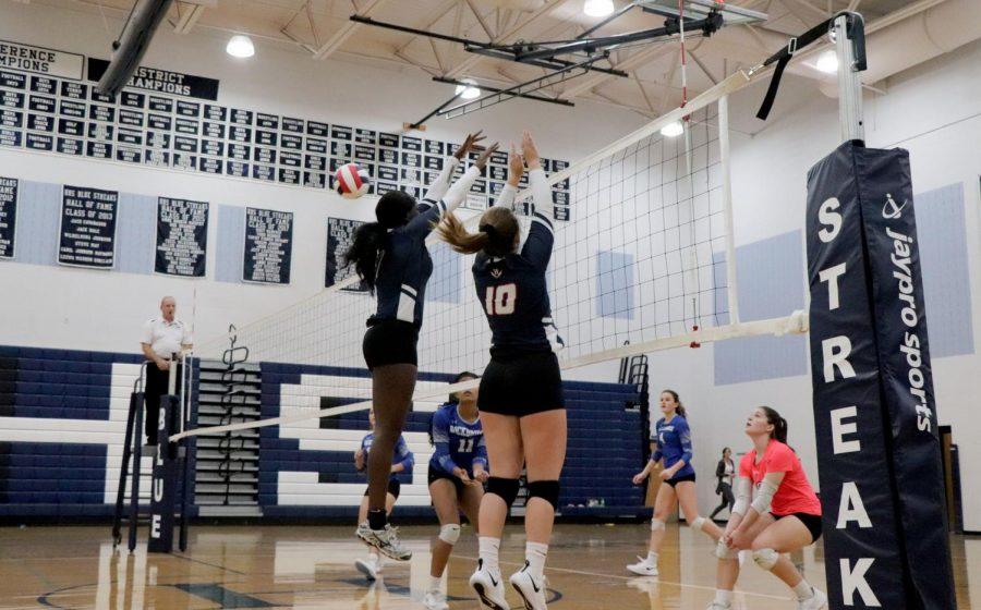 Senior Atilia Thomas and Sophomore Maya Waid go up for the block.