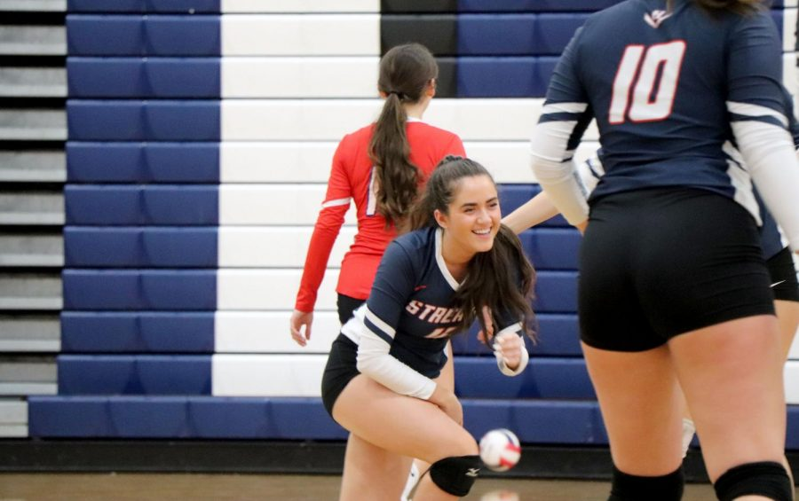 Senior Sydney Plowman gets up after diving for a ball.