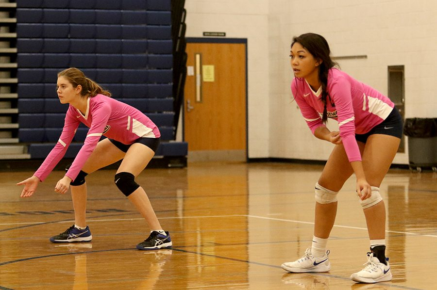 Freshman Kai Blosser (left) and Phengsitthy wait for the ball to come back over the net. The Streaks won the game in two sets.