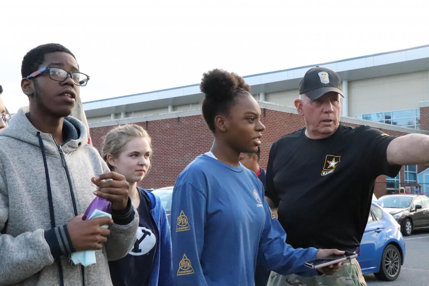 Sergeant Major directs students to the different activities. A collaboration between Mary Strickler and the JROTC program was used to give students a real life experience of the book 'Into Thin Air.'
