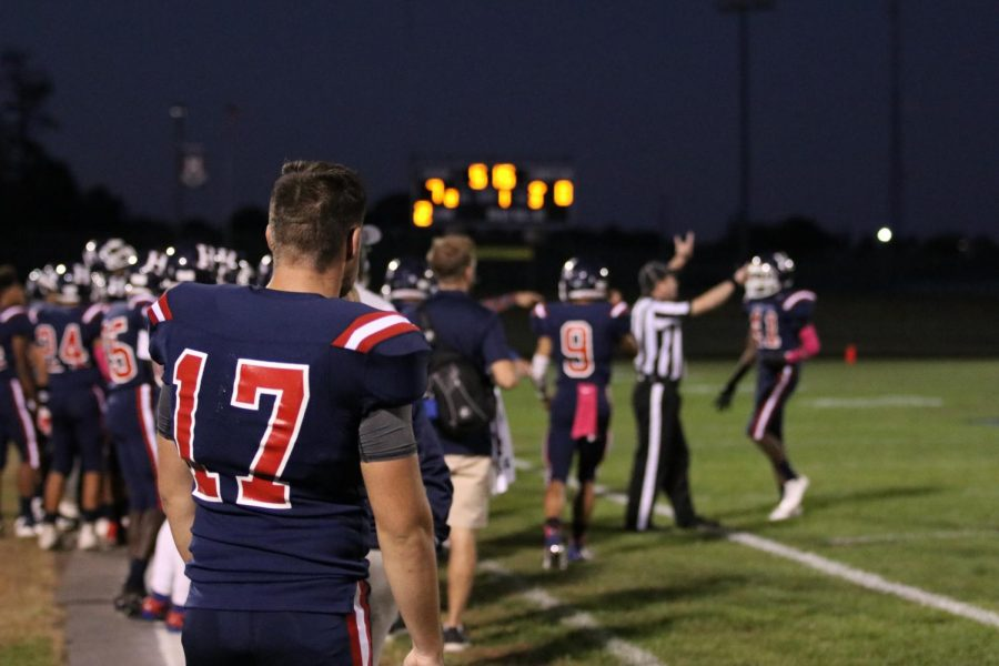 Senior kicker, Mateo Peric (#17) prepares to go on the field after a failed third down attempt.