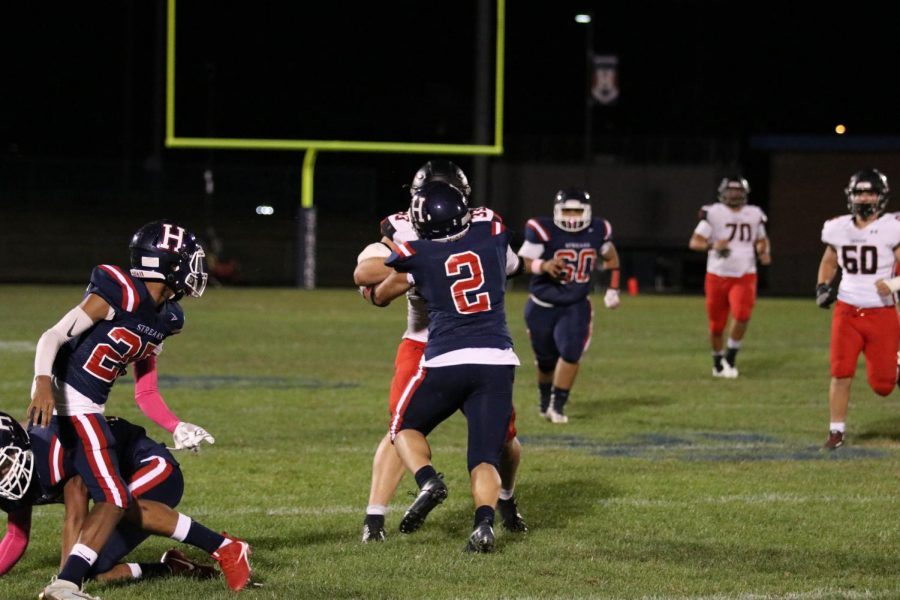 Defending an offensive attack by Shernado, senior defensive back, Jose Ayala (#2), goes head to head with a Sherando lineman.