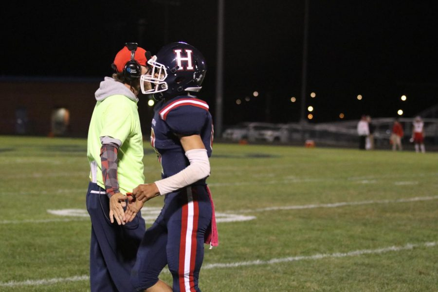 After a touchdown, senior  Kwentin Smiley runs off the field.