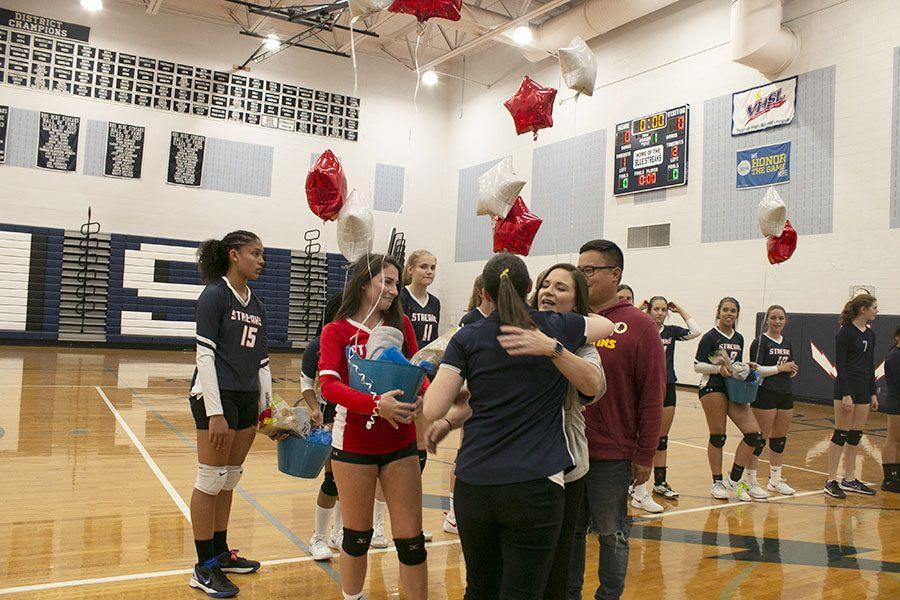Head coach Hannah Bowman-Hrasky hugs Amy Sabarre, McCollum's mom.
