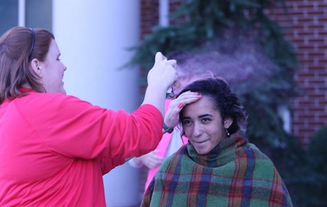 Senior Alyce Kilby-Woodward gets her hair dyed pink at the Red Sea tailgate prior to the pink out football game.