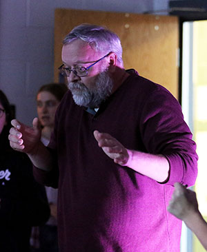 History teacher Mark Tueting joins the students to dance during the first drama club eat and greet.