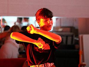 Freshman Azalea Twining dances during drama club.