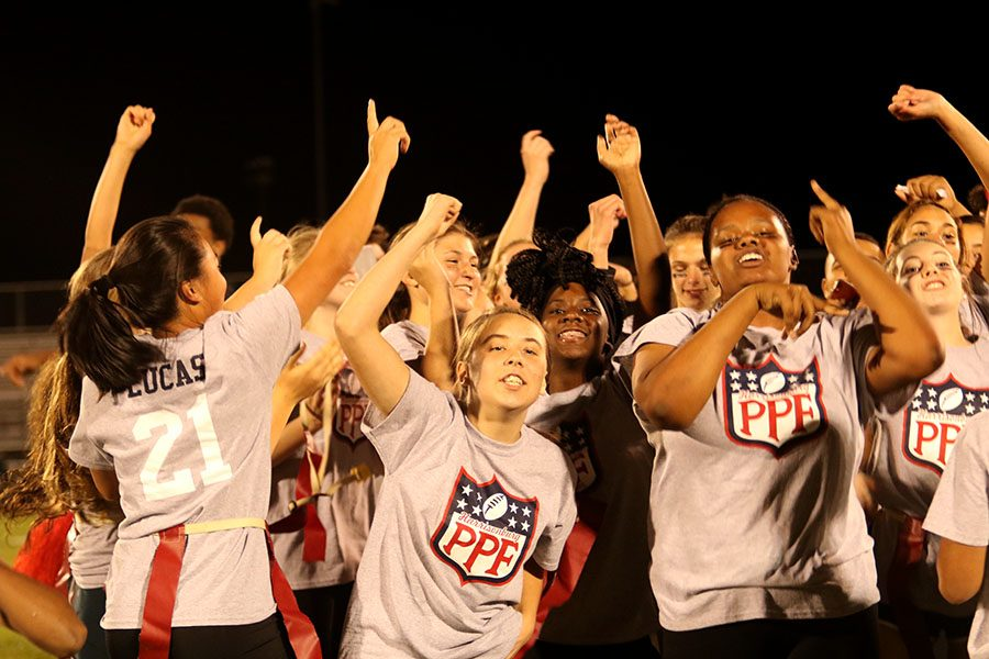 The+juniors+celebrate+their+win+following+the+game%2C+this+is+one+of+the+first+times+in+our+school+history+that+the+juniors+have+beaten+the+seniors+in+powderpuff.