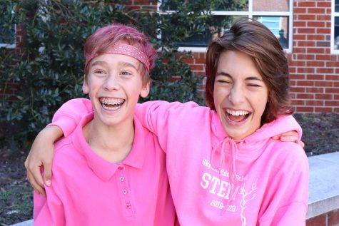 Freshmen Levi Zook and Palmer Hall wear pink to support breast cancer awareness on pink out day.